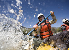 Whitewater Rafters Splashing Water --- Image by © Royalty-Free/Corbis